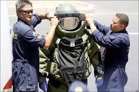 July 2013. US experts place Cher Lloyd in a soundproof containment suit.